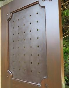 Steel:  Custom stain sealed with Renaissance Wax.  Wood: Epifanes marine varnish.