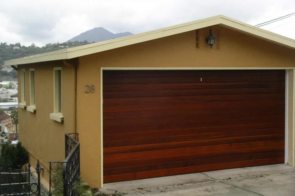 Sikkens Cetol on new garage door. Stucco: C2 exterior paint. San Rafael, CA. Marshall Johnson Painting.
