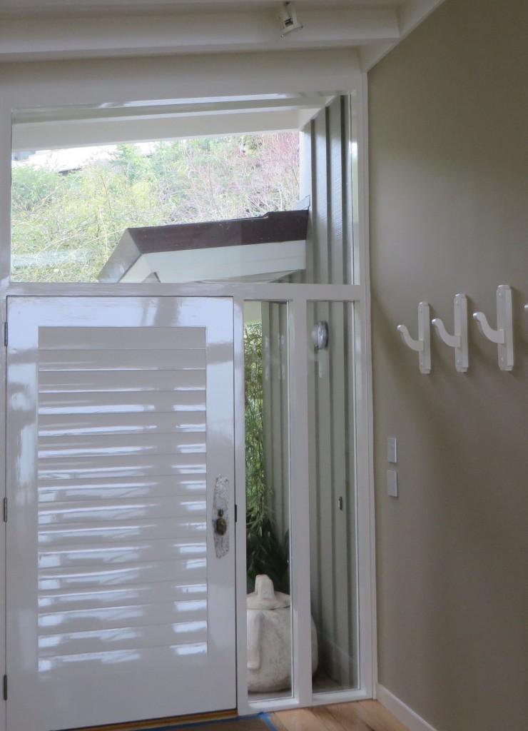 Hollandlac Brilliant, front door.  C2 Cabinet and Trim Paint, cloak hooks.